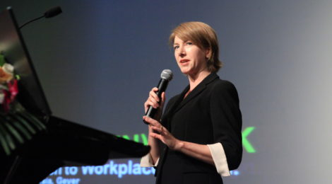 Image of Caroline M. Burns presenting at a conference