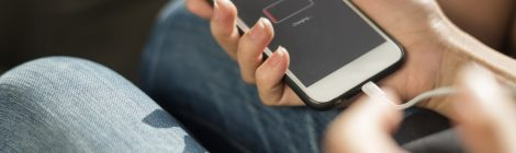 Image of woman in jeans with her hands holding a smartphone
